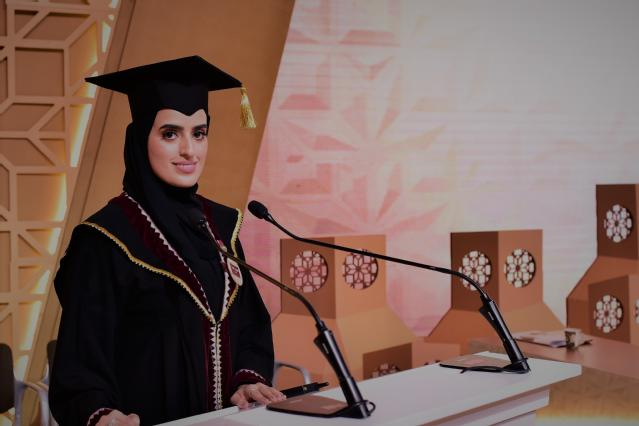 Aisha Al-Mulla, representing the Class of 2019, delivers an opening speech at the event.